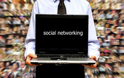 Social networking. Man with laptop and people background, social media concept