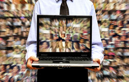 Social networking. Man with laptop and people background, social media concept Stock Photos