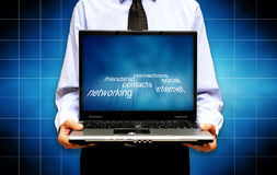 Social networking. Man holding a  laptop, concept for social networking Royalty Free Stock Image