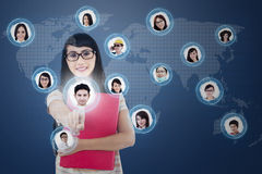 Social networking. Asian student choosing her partner on social network by using futuristic interface Stock Photo