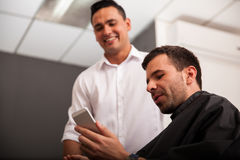 Social networking at a barber shop Royalty Free Stock Images