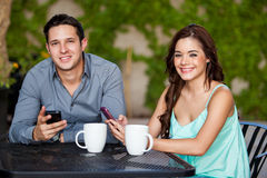 Social networking at a cafe Royalty Free Stock Photos
