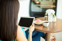 Social networking on a coffee shop Stock Image