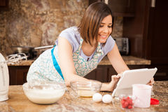 Social networking while cooking Royalty Free Stock Photography