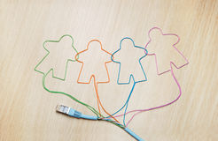 Social networking. Ethernet cable shaping silhouettes of virtual users Stock Photo