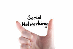 Social networking. Note between two fingers Royalty Free Stock Image