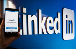 Social networking service LinkedIn. MOSCOW, RUSSIA - February 2, 2017: Smartphone with Linkedin.com homepage on the screen. LinkedIn is a business-oriented royalty free stock photos