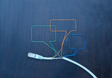 Social networking. Speaking bubbles made of ethernet cable Royalty Free Stock Photography