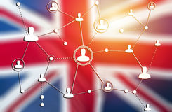 Social networking technologies on a Great Britain flag Stock Images