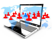 Social networking technologies and world map on a laptop Stock Photography