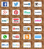 Social networking websites logos and brands. Collection of logos and brands of  most famous social networking websites on white tablet on rusted wooden Royalty Free Stock Images