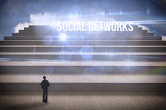 Social networks against steps against blue sky Royalty Free Stock Photos