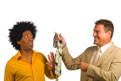 Social pressure. Bohemian artist type of guy under pressure to wear a tie Stock Photo