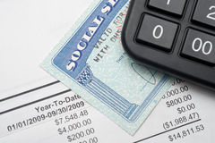 Social security. A calculator, social security, and financial statement Stock Image