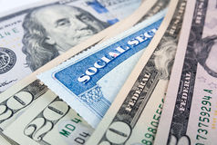 Social security card and American dollar bills Stock Photography