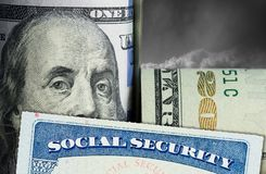 Social Security Card in front of Benjamin Franklin on dollar note Stock Images