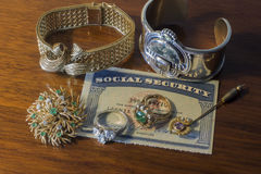 Social security card with jewelry Royalty Free Stock Images