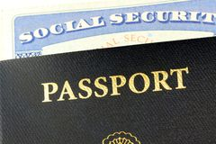 Social security card and United States passport. Travel Documents - United States Passport with Social Security Card Closeup Royalty Free Stock Photo