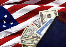 Social Security Card and US Currency on an American Flag Royalty Free Stock Photo