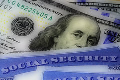 Social security card and US currency one hundred dollar bill Stock Image