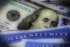 Social security card and US currency one hundred dollar bill Royalty Free Stock Photo