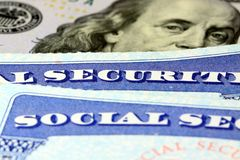 Social security card and US currency one hundred dollar bill Stock Images