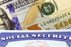 Social security card and US currency one hundred dollar bill Royalty Free Stock Photos