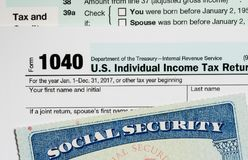 USA Social Security Card on calculations of tax for retirement Royalty Free Stock Photo