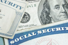 Social security cards. And US money - retirement concept royalty free stock images