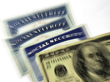 Social Security Cards and Cash Money. Detail of several Social Security Cards and cash money symbolizing retirement pensions financial safety royalty free stock photography