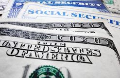 Social Security cards and money. Closeup of Social Security cards and money royalty free stock images