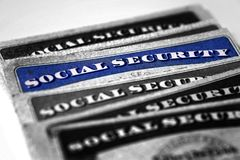 Social Security Cards in a Row Pile for Retirement Stock Photography
