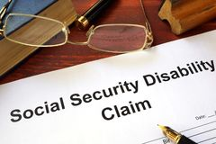 Social security disability claim on a table. Social security disability claim on a wooden table Royalty Free Stock Photo