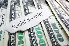 Social Security. Newspaper scrap on assorted money Stock Image
