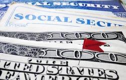 Social Security retirement flag. Closeup of Social Security cards and money with Retirement flag stock photo
