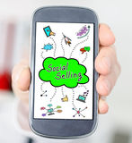 Social selling concept on a smartphone. Hand holding a smartphone with social selling concept Royalty Free Stock Photography
