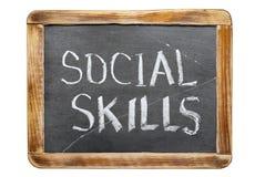 Social skills fr. Social skills phrase handwritten on vintage school slate board isolated on white Royalty Free Stock Photos