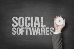 Social softwares text with businessman hand on blackboard Stock Photos