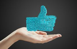 Social  symbol like. Sign like in hand on a black background Royalty Free Stock Images