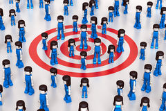 Social Target Group. 3D rendered illustration of people, with a central group standing over a red target symbol Stock Photo