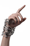 Social theme: hands tied a metal chain on a white background Stock Photos