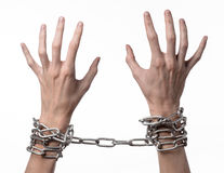 Social theme: hands tied a metal chain on a white background Royalty Free Stock Photo