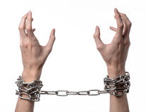 Social theme: hands tied a metal chain on a white background Royalty Free Stock Photos