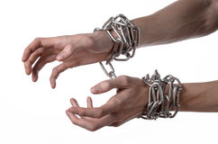 Social theme: hands tied a metal chain on a white background Royalty Free Stock Images