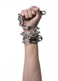 Social theme: hands tied a metal chain on a white background Stock Photo