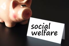 Social welfare. Concept with money and piggy bank on black background stock photos