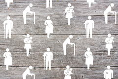 Social welfare concept on wooden background Royalty Free Stock Photography