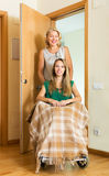 Social worker and disabled girl. Friendly social worker and disabled girl on chair returning home Stock Images