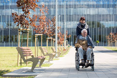 Social worker and disabled man Royalty Free Stock Photography
