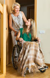 Social worker and disabled woman Stock Photos